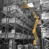 работа подъемника HA12IP в складском комплексе